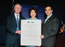 (L-R) Roy Grizzard, Assistant Secretary of Labor for Disability Employment Policy; Elaine L. Chao, Secretary of Labor; and Hector V. Barreto, Adminstrator of the Small Business Administration with the newly signed Strategic Alliance Memorandum at the Department of Labor on Thursday, Dec. 11. (DOL Photo/Neshan Naltchayan)